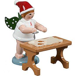 Bäckerengel mit Mütze und Ausstechform am Tisch  -  6,5cm