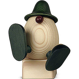 Egghead Father Anton  with flower sitting/dancing, green  -  15cm / 5.9inch