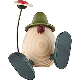 Eierkopf Alfons mit Blume sitzend/tanzend, grün  -  11cm