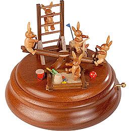 Elektronische Spieldose  -  Hasenspielplatz mit beweglicher Wippe  -  16cm